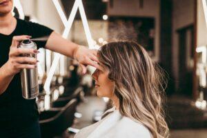 A woman getting hair treatment