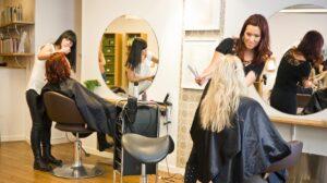 woman getting hair treatment in Salon